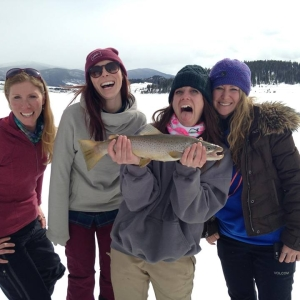 excited friends enjoy catching big browns during ski season copper