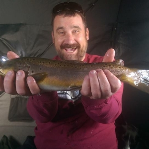 elated client with a big brown on a nymph dropper
