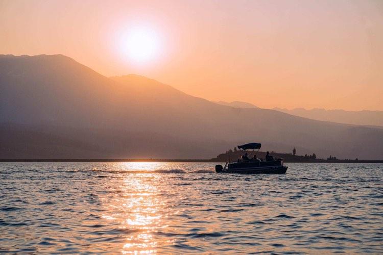 beautiful smokey colorado sunset lake fishing from pontoon boat