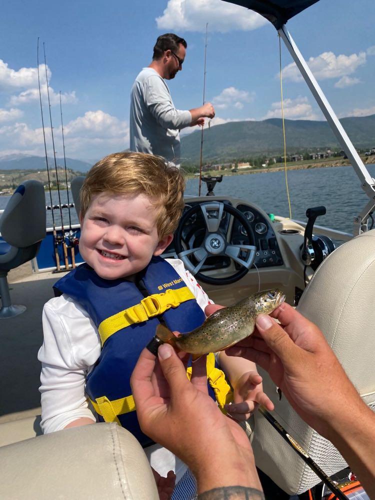 toddler fishing for fingerlings hatchery
