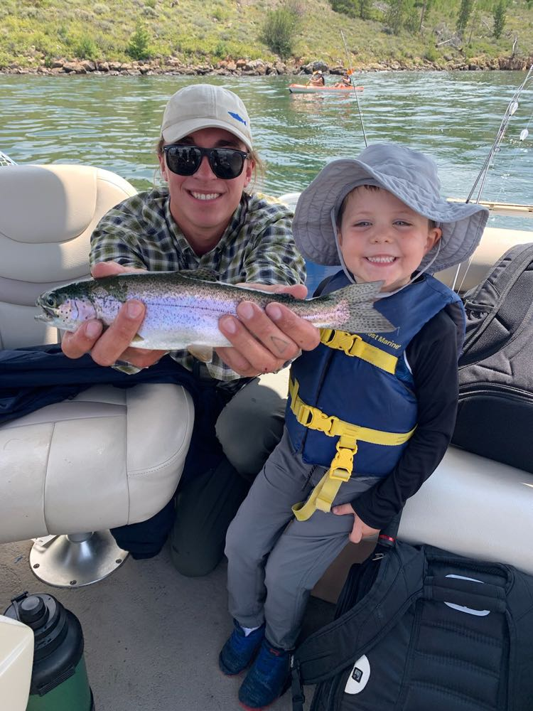Captain Austin with a beautiful family rainbow trout