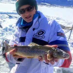 skier catches brown trout inbetween jibs